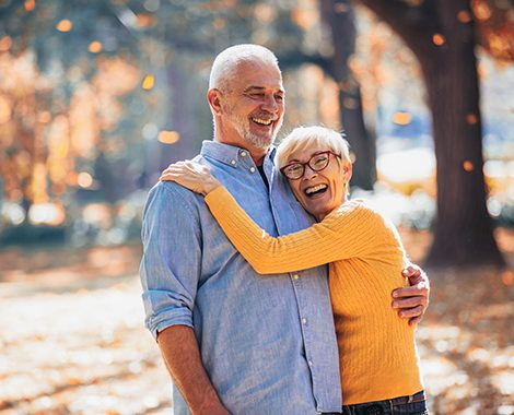 happy elderly couple posing for the photo at a park