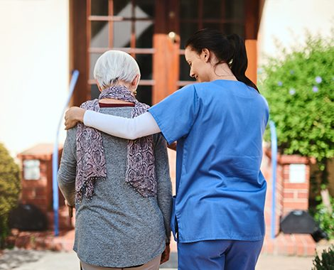 nurse walking with elderly patient