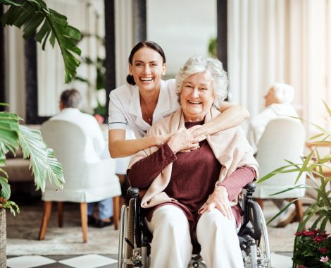 Elderly woman posing with her caregiver